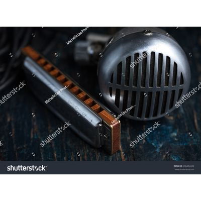 blues---stock-photo-blues-harmonica-with-microphone-496434328