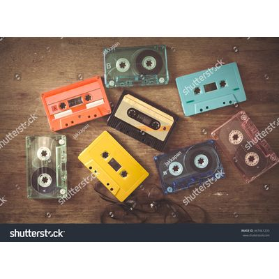 Brock---stock-photo-top-view-above-shot-of-retro-tape-cassette-on-wood-table-vintage-color-effect-styles-447461233
