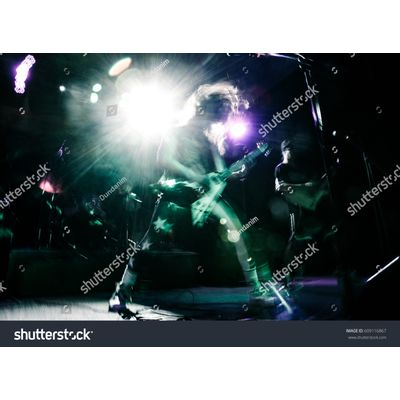 heavy-metal---stock-photo-rock-star-playing-guitar-at-music-live-concert-609116867